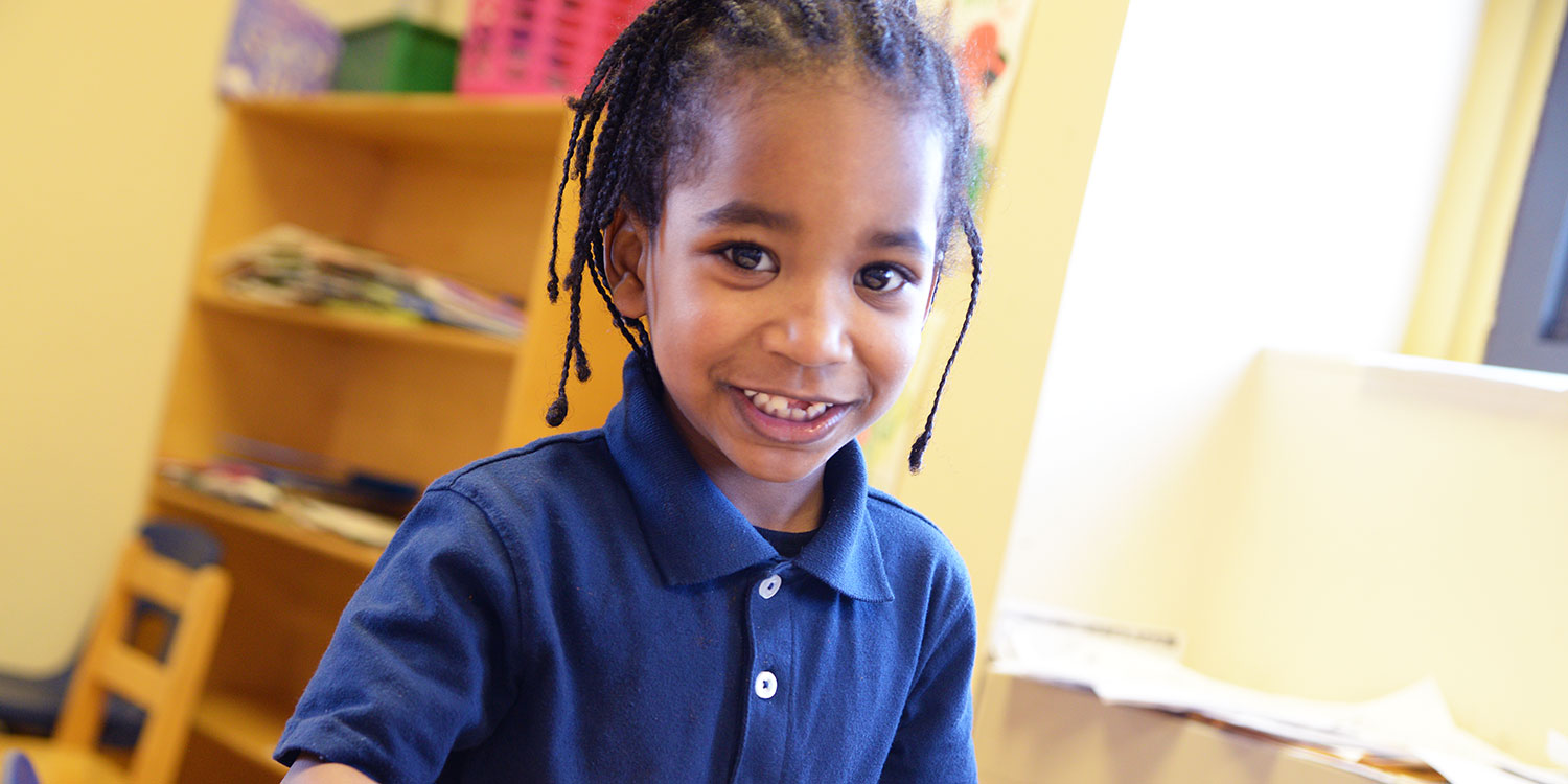 Young elementary student smiling.